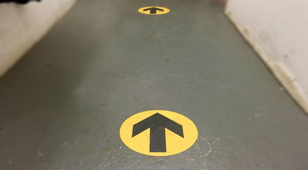 one way flow floor arrow signs